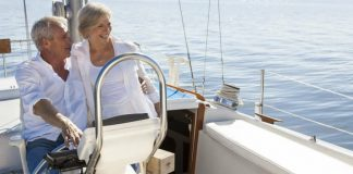 Happy retired couple on a yacht