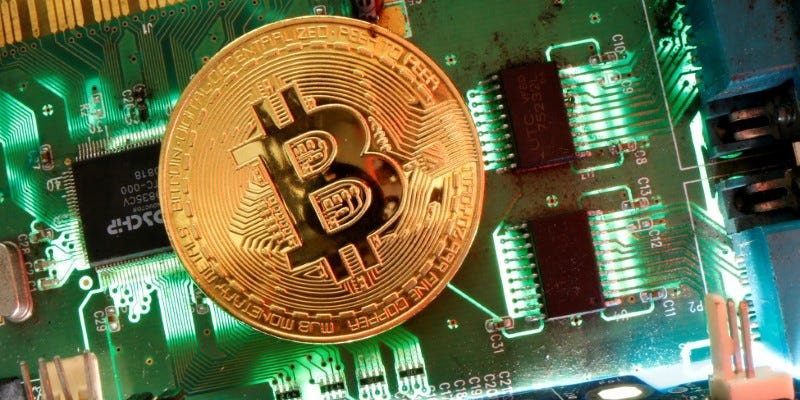 FILE PHOTO: Representation of the virtual currency Bitcoin is seen on a motherboard in this picture illustration taken April 24, 2020. REUTERS/Dado Ruvic /Illustration/File Photo
