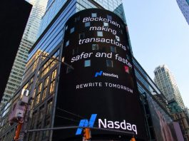 "Blockchain billboard in Times Square, New York City, saying ""Blockchain making transactions safer and faster. Nasdaq."" Image by Pascal Bernardon, via Unsplash.com."