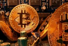 FILE PHOTO: A small toy figure and representations of the virtual currency Bitcoin stand on a motherboard in this picture illustration taken April 17, 2020. REUTERS/Dado Ruvic/Illustration