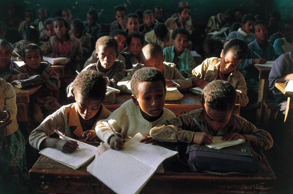 Children in a classroom in Gondar in the Amhara Region. Ethiopia has signed a deal to register 5 million school children using blockchain. Image: DeAgostini/Getty Images.
