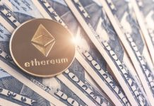 Ethereum coin sitting on top of dollar notes