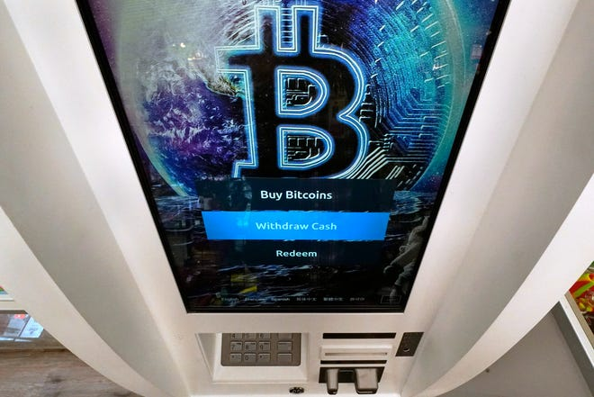 The Bitcoin logo appears on the display screen of a crypto currency ATM in Salem, N.H.    Before dabbling in crypto, it helps to get your financial house in order, experts say. That means setting money goals, building your savings and contributing to retirement accounts and educating yourself on how crypto works.